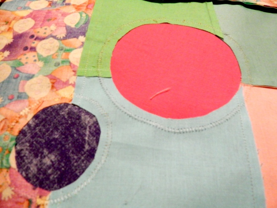 (back of quilt top, showing the circles trimmed out.)