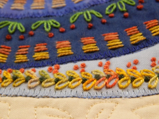I have added french knots and lazy daisy stitches to the traditional running stitch of kantha.